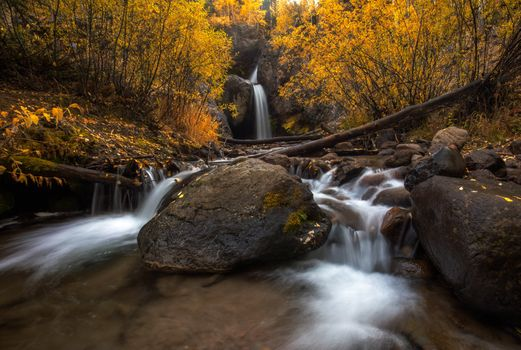 Autumn waterfall and boulders · free photo