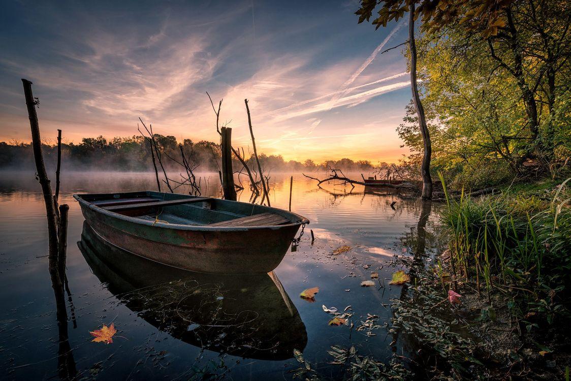 оригинальный подарок лодка с отражением на закате фото требует