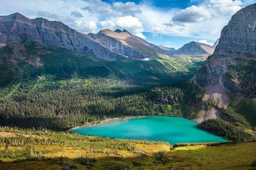 Бесплатные фото Glacier National Park,Grinnell Lake,горы,озеро,деревья,небо,облака,природа,пейзаж