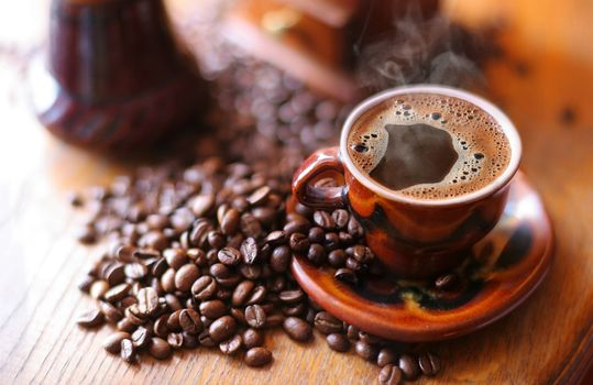 Coffee with froth and coffee beans · free photo