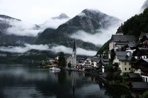 Бесплатные фото городской пейзаж,здание,город,озеро,отражение,облака,небоскреб