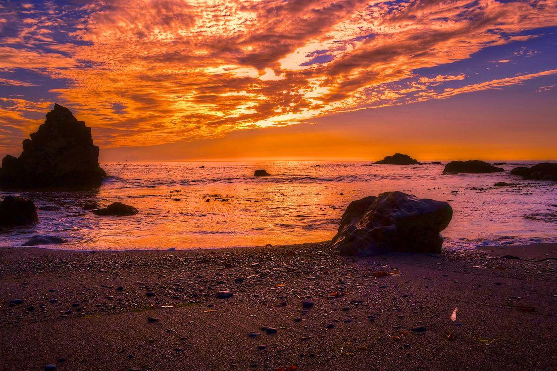 Янтарный закат на море · бесплатное фото
