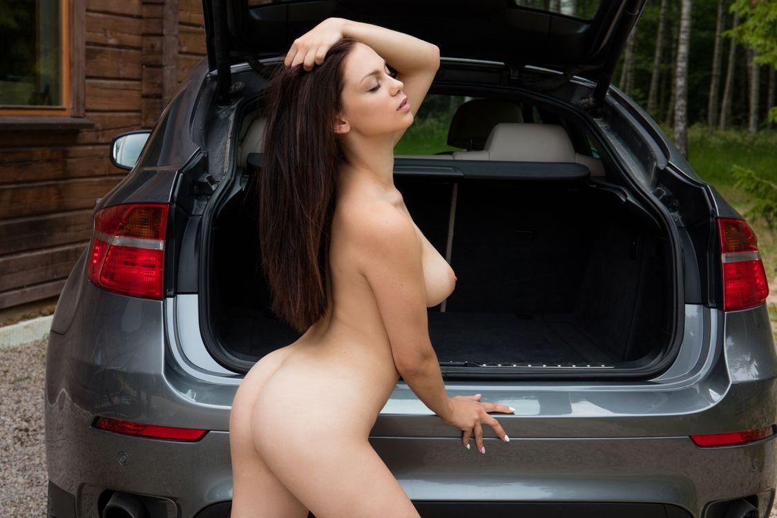 Naked girls posing on cars 10