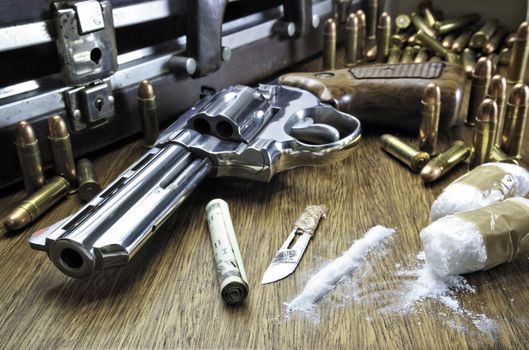 A revolver and ammunition on the table · free photo