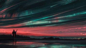 Пара смотрящая в ночное небо · бесплатное фото