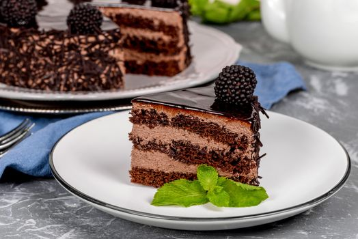 A piece of cake with blackberries · free photo