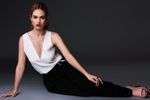 Photo free Lily james, in a white blouse, black pants