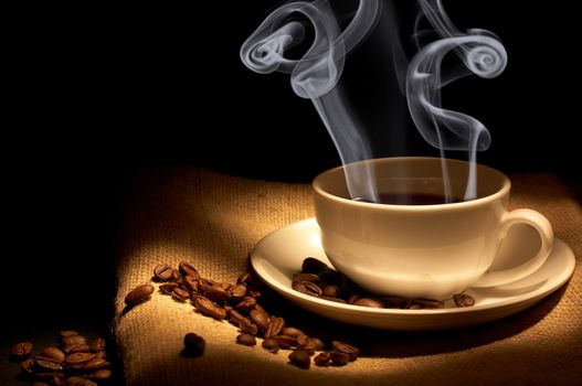 The steam from the hot coffee · free photo