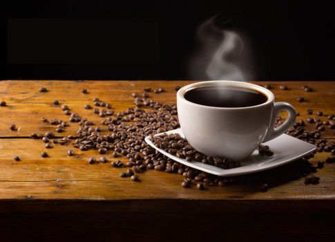 Coffee on a black background · free photo