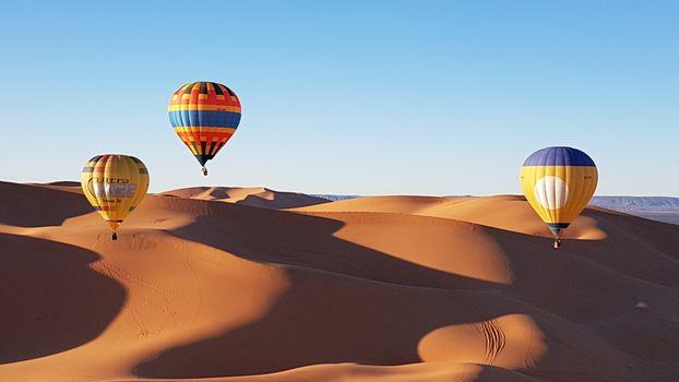 Бесплатные фото воздушные шары,пустыня,глобос,полеты на воздушном шаре,воздушный шар,окружающая среда,небо,вид транспорта,песок,дневное время,дюна,пейзаж