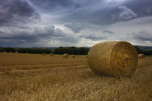 Bales on a background of the gloomy sky · free photo