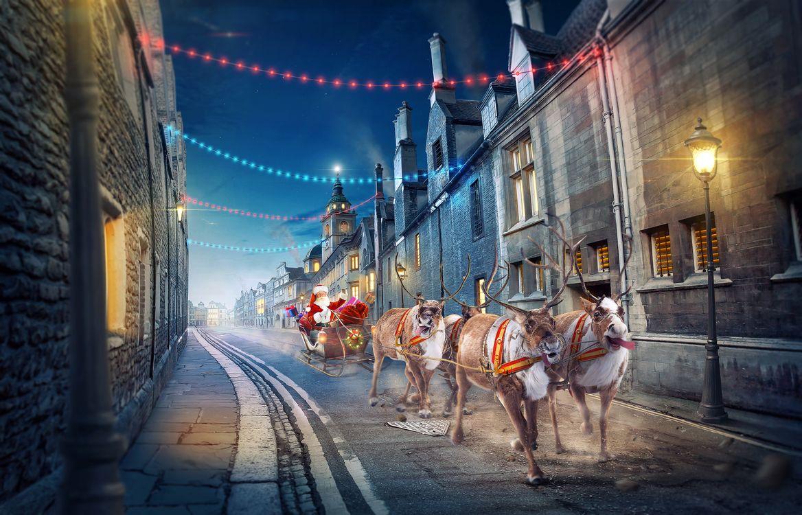 Фото бесплатно santa-claus, город, улица, новогодний экспресс, олени, зима, новый год, рождество, новогодние обои, дед мороз, упряжка, фонари, art, новый год