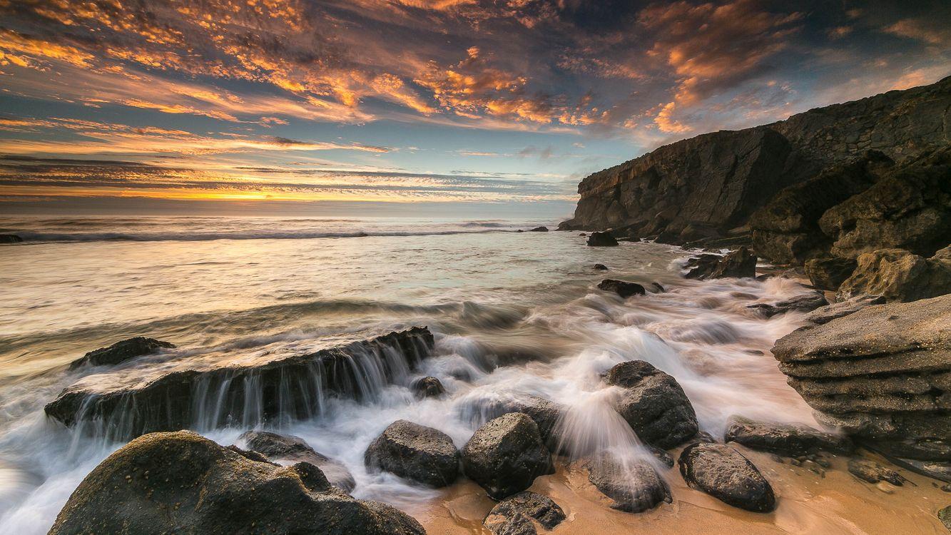Фото бесплатно море, закат, волны, берег, камни, скалы, пейзаж - на рабочий стол