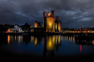 Photo free The Caernarfon castle, a medieval castle located in the town of Carnarvon, the County Gwynedd region of Wales