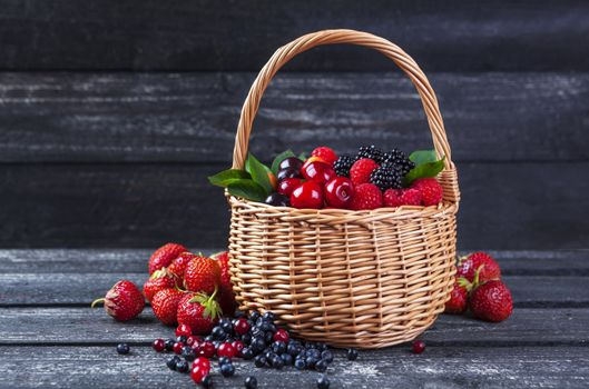 Berry crop in a basket · free photo