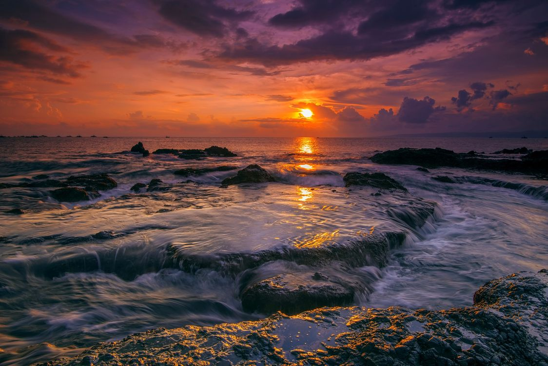 Free photo the province of West Java, sunset on the beach Lodge, Indonesia sunset - to desktop