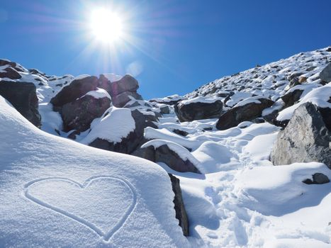 The figure of a heart in the snow