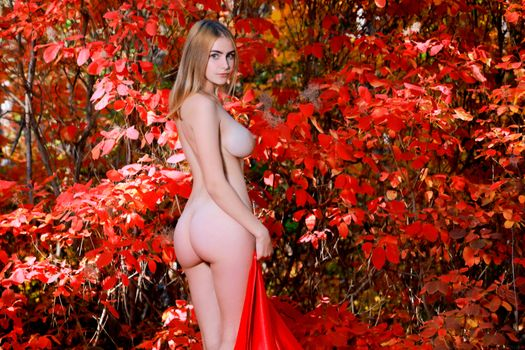 Naked girl in the fall
