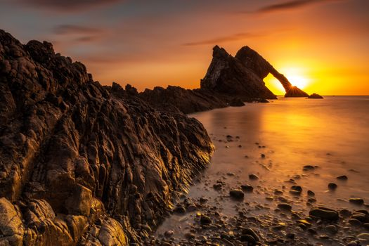 Silhouettes of rocks at sunset · free photo