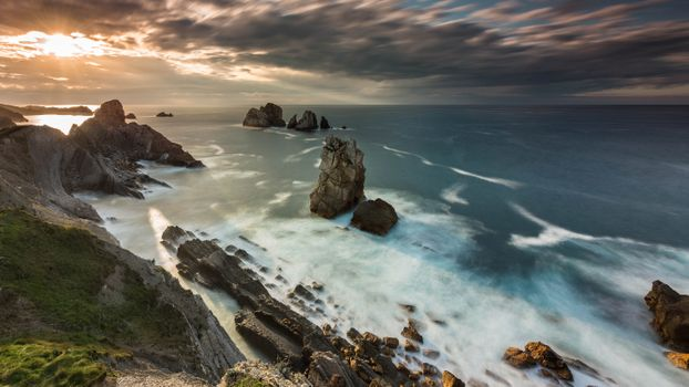 Light through the clouds over the sea · free photo