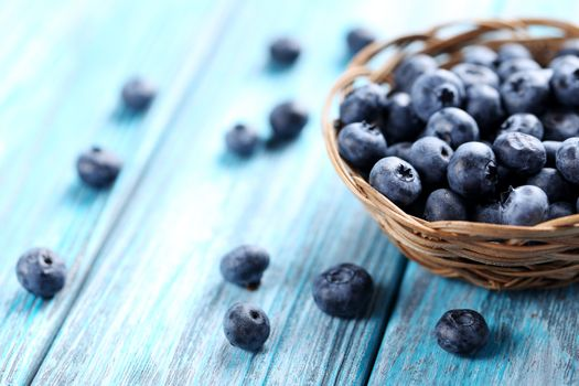 Blueberries on the painted wooden table · free photo