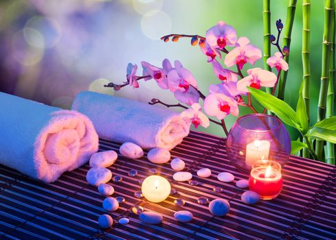 Photo free heart massage with candles, orchids, towels and bamboo massage