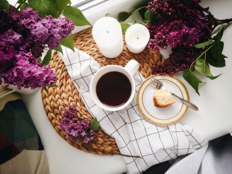 Coffee, candles and lilac · free photo