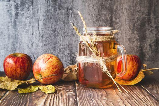 Apple juice in a glass mug · free photo