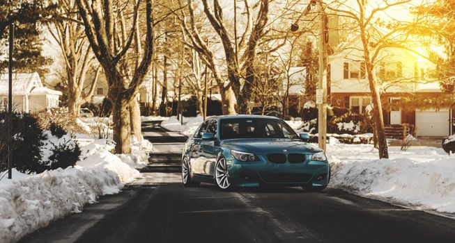 BMW E60 on a country winter road · free photo