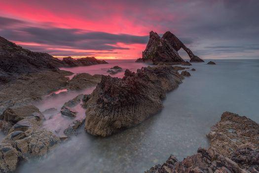 Rocks on the sunset sky background · free photo