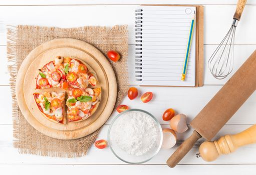 Pizza and notebook for recipes · free photo