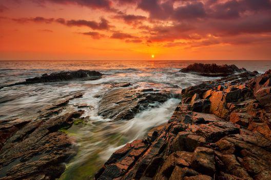 Rocky coast at sunset · free photo