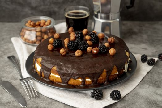 Cake with nuts and blackberries · free photo
