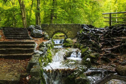 Arched bridge in the old Park · free photo