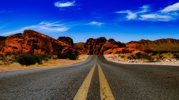 Photo free valley of fire state park, long road, clouds
