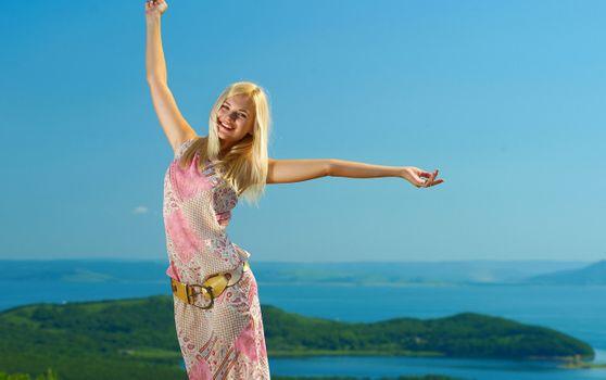 Talia posing in summer dress · free photo