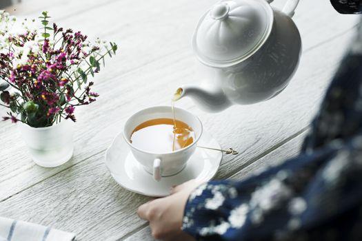 Photo free herbal tea, white pot, cup