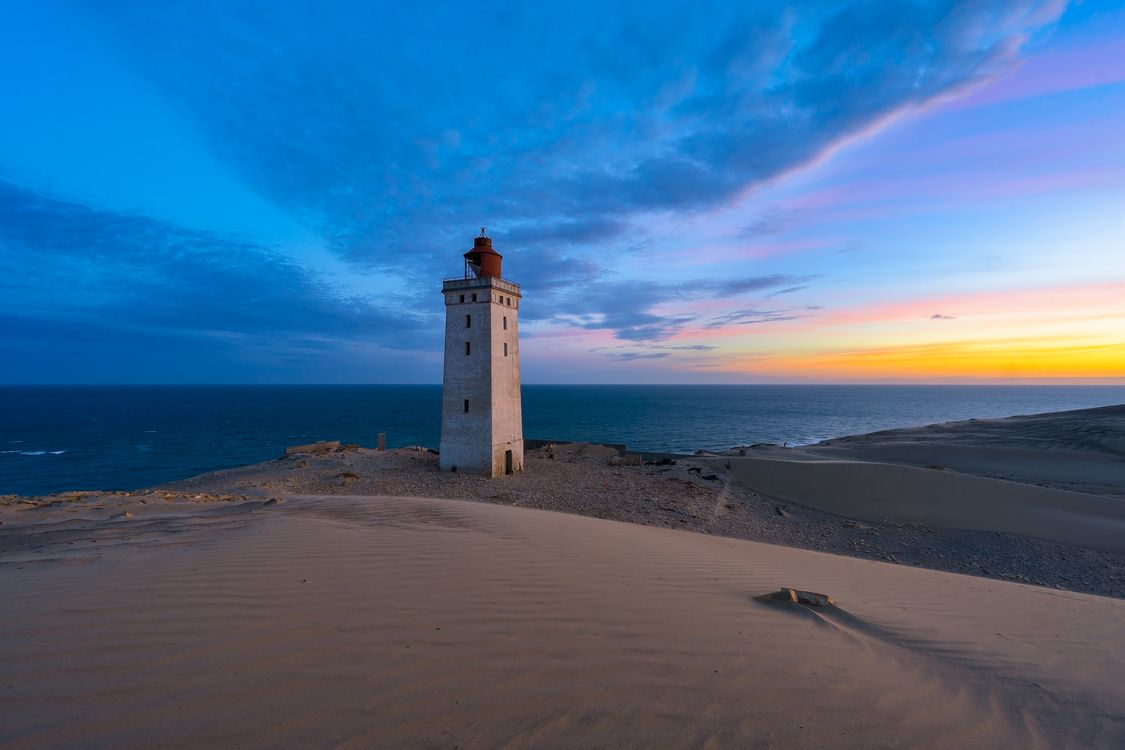 Free photo Lighthouse Rubjerg the Knud, Rubjerg Knude Lighthouse, North sea coast in Roberge, Jutland, Hj rring, Denmark, sunset - to desktop