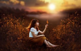 Chinese girl with flower on background of sunset · free photo