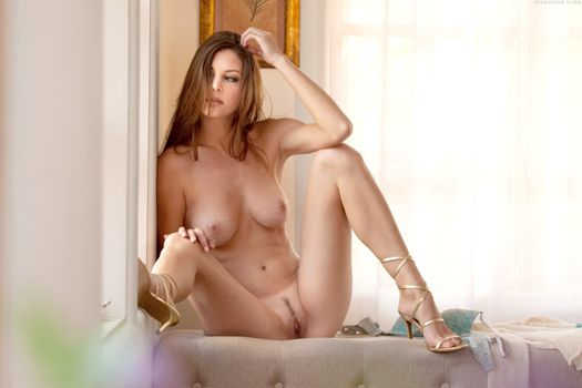 Amber Sym naked at the window