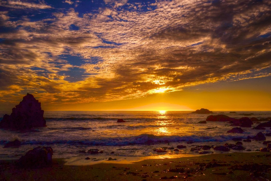 Закат на морском пляже · бесплатное фото