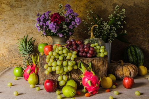 Flowers and fruit platter · free photo