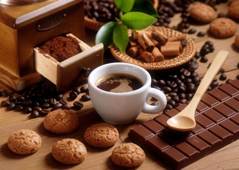 Coffee with cookies and chocolate · free photo