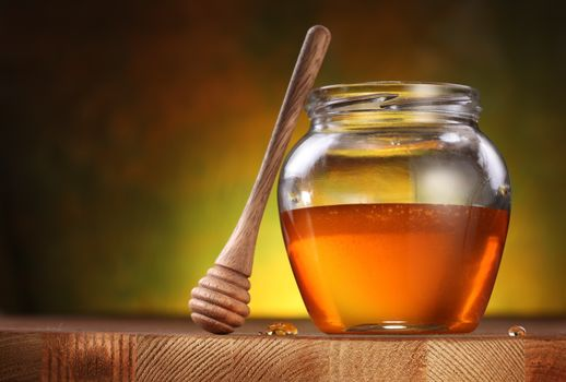 Golden honey in a jar · free photo