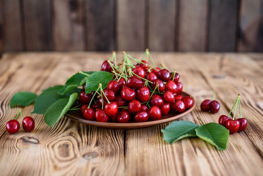 Plate with tasty cherries · free photo