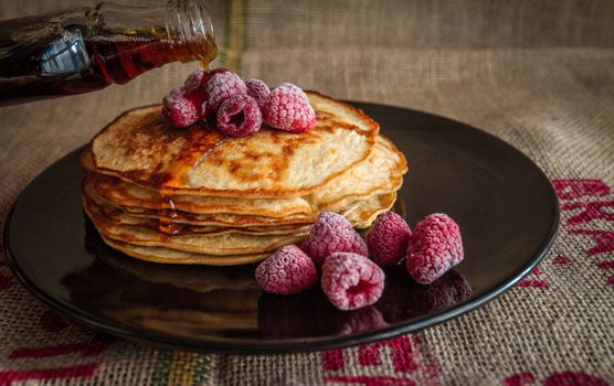 Pancakes with syrup and raspberries · free photo