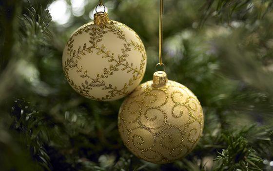 Бесплатные фото Новый год,Рождество,елочные украшения,gold,balls,background color,Christmas,decorations
