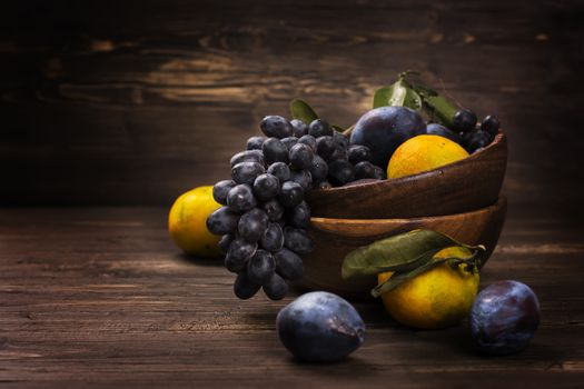 Plums, grapes and lemons · free photo