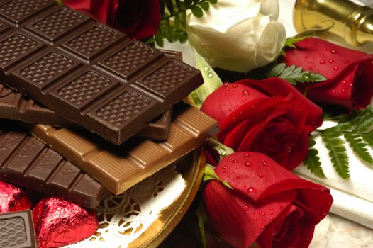 Roses and chocolate bars · free photo