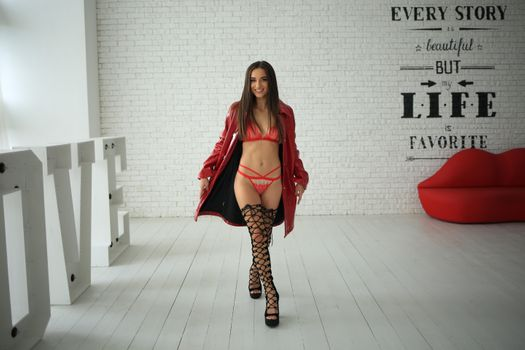 Naked in a red coat · free photo